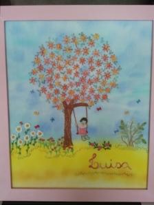 Enfeite da maternidade, que hoje está no quarto da Luisa. É bordado, feito à mão pela minha mãe (ela aceita encomendas).